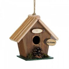 Pine Cone Rustic Wood Birdhouse A little cabin with natural touches, made just for the birds! This adorable classic birdhouse features a sweet little welcome sign, pine cone decoration, and a single entrance. Wooden Bird Houses, Decorative Bird Houses, Wren House, Pine Cone Decorations, Wood Bird, Little Cabin, Pine Cones, Rustic Wood, Outdoor Decor
