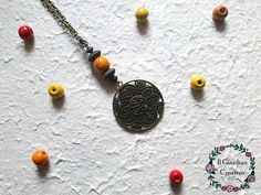 Collana Maishi con perla in legno e pendente traforato