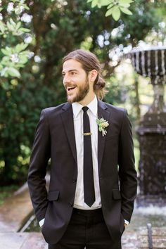 a groom that isn't afraid to rock a man-bun