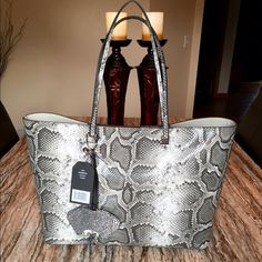 NWT.. Christian Siriano Sabrina Natural tote NWT.. Christian Siriano Sabrina Natural gray tote. Synthetic Python, double strap and magnetic closure. Sold out! Gorgeous bag! This is a large tote. Brand-new with tags. 17 x 6 x 11.  make me an offer Christian Siriano Bags Totes