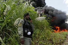 Thick smoke billows into the sky, as confiscated drugs are burnt in Panama City. Anti-narcotics police destroyed several tons of cocaine and other illegal substances, which were seized during operations across the country. Drug Cartel, Union Flags, War On Drugs, Documentary Photographers, Panama City Panama, Police Officer, Bradley Mountain, Documentaries, September 19