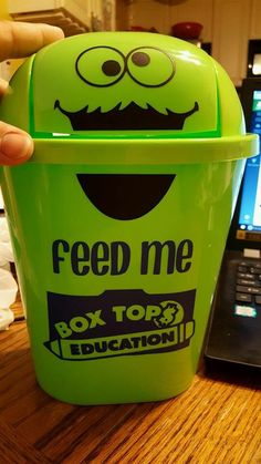 Box top trash can for each grade. $1 store trash cans and made with cricuit cutter (online)