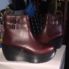 Doc Martens platform boot brand new size 7 Brand new Doc Martens boots, never worn, no tags. Second photo is with flash. Color is called Oxblood but they look more brown to me! Runs true to size and will stretch (less than half a size) make an offer! Doc martens Shoes Ankle Boots & Booties