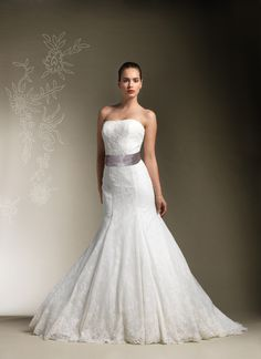 Refined Lace Wedding Gown Combines Strapless Neckline Trumpet Train