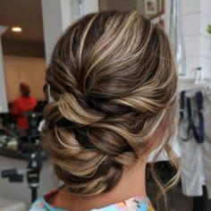 Textured updo hairstyle , chignon hairstyle #weddingupdo #chignon #bridehair