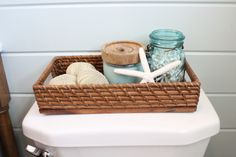 Bathroom. Would a basket on the toilet lid be asking for trouble?