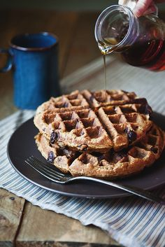 [ Recipe: Whole Wheat Pumpkin Chocolate Chip Waffles ] Using coconut oil, pumpkin puree, eggs, milk, vanilla, whole wheat flour, ground flax seed, wheat germ, ld fashioned oats, pure maple syrup, baking powder, baking soda, cinnamon, and chocolate chips. ~ from InTheLittleRedHouse.blogspot.com