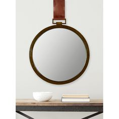 Inspired by vintage pocket watch finds at the flea markets of London and Paris, the warm amber Time Out beveled mirror with leather strap gives instant character and charm to any room with the simple lines of its artisan hand-wrought iron frame.