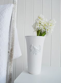 White Home Accessories From The White Lighthouse The White Vase With A Bird Emblem