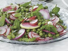 Few things say spring like fresh green peas. Pair them with radishes for a  dish with beautiful garden color .