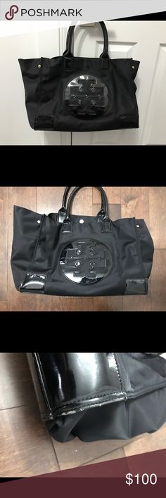 Tory Burch large tote Huge bag that holds a lot!! Black and the material works great in the rain! Has a little wear on the bottom of the bag but other wise great condition . Tory Burch Bags Totes