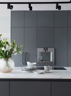 Modern grey kitchen with marble countertop. The perfect minimalist look.