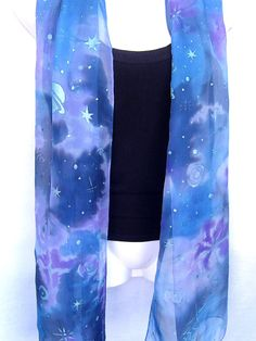 Nebula silk scarf, galaxy, space design, hand painted in silver on transparent chiffon, in shades of blue with accents in purple, lavender and gray, one of a kind, delicate and sheer, handmade women fashion accessory by Silkshop on Etsy. The scarf is vibrant and bright in colors, completely