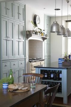 Grey Floor to ceiling cabinets and diner table in kitchen