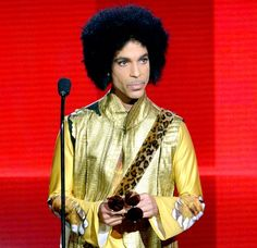 Prince Dead: Legendary 'Purple Rain' Singer Dies at 57  pic of him onstage during the 2015 American Music Awards.