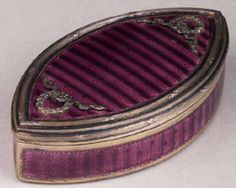 A late 19th century Austrian silver and enamel elliptical snuff box by Georg A. Scheidt, Vienna.