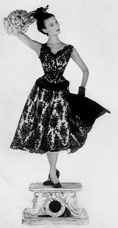 black lace and taffeta vintage dresses like this beauty from 1954.