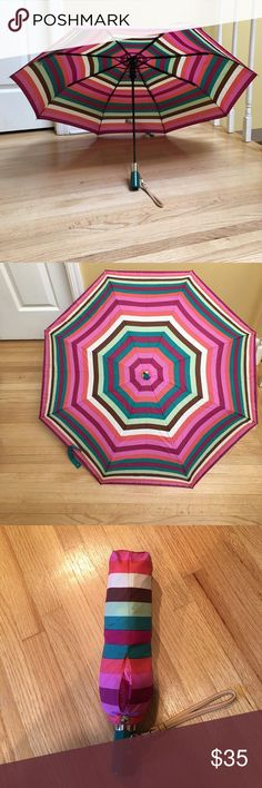 """New! Coach Umbrella 🌂 Multi-Color New multi-colored Coach umbrella! I did remove and discard the tags, but never used the umbrella. In the pictures, you can see the wrist strap on the umbrella partially has the original packaging, which was never removed (showing its new). This umbrella does open with a push button and also comes with a case. Closed- 7"""" length. Open (top to end of the handle)- 21"""" length. Width open-35"""" across.  *Please do check out my closet for the matching cosmetics bag…"""