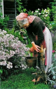Tasha Tudor~ I love the pictures with her cat. Such affection.