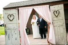 old doors, engraved hearts & a curtain ... perfect wedding ceremony entrance from Terri & Jim's small-budget, handmade Middle River wedding in Maryland