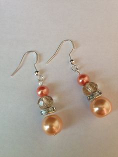 Handmade earrings with coral beads, available on Etsy