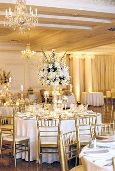 photographer: Michelle Lange Photography; Ivory and gold ballroom wedding reception idea;