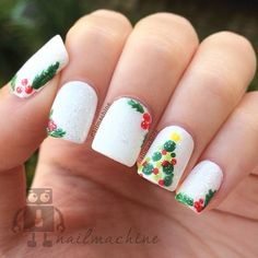 christmas by nailmachine...Kind of ugly execution, but I like the idea of moving the holly leaves around
