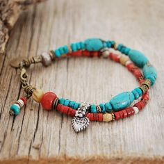 gypsy bracelet - turquoise, red coral, lotus and heart charm - yoga jewelry. $45.00, via Etsy.
