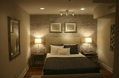 Lighted exposed brick for windowless bedroom