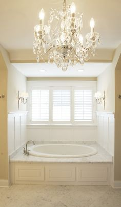 Master bath...our tub is in a recess like this but I don't know how hubby would feel about the paneling.