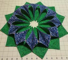 Pretty table wreath I made. Fold n stitch wreath.