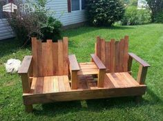 A Two-seater With Integrated Table Out Of Repurposed Pallets Two-seater bench, 6ft long made out of 4x4 and 2x4s decorated with the beautiful pallet wood.