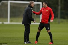 David Moyes and Robin van Persie were deep in discussion at the Carrington training ground