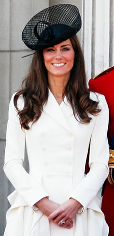 June 11, 2011  For the Trooping the Colour ceremony, Catherine Middleton and Prince William returned to the balcony where they shared their first kiss as a married couple. Middleton wore a sculptural white coat by Alexander McQueen.