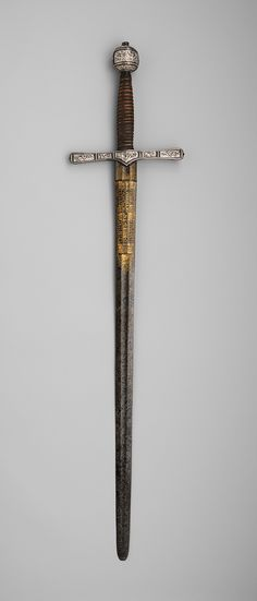 Cross-hilt sword, 1600–1625  England (London) and Germany (Solingen)  Iron, silver, wood, copper alloy, steel, and gold