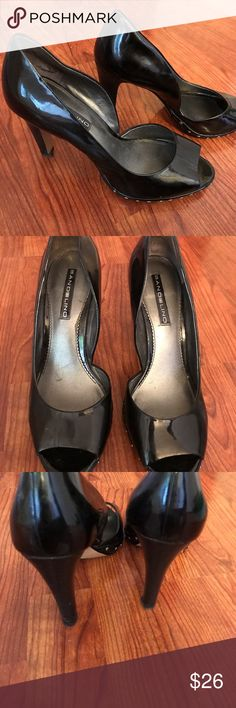 Bandolino Black Peek a boo Heels - Size 8M Pre-owned Gently worn Black Patent leather heels. Heel measures 4 inches. These were only worn a handful of times. Great for homecoming and prom. Size is 8M. Bandolino Shoes Heels