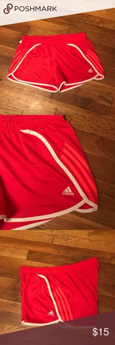 Adidas red and pink shorts Adidas shorts size large adjustable waist base color red stripes pink no rips or stains 100% polyester have any questions please ask adidas Shorts