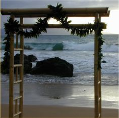 A little like the bamboo arch. Would be nice with white material draped like this and a few colored flowers