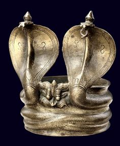 India | Upper arm bracelet with double-headed cobra; bronze.  | Andhra Andhra Pradesh | Ghysels Collection.  Photo Credit: Frédéric Dehaen