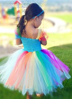 No Sew Rainbow Tutu Tutorial    Even if you can't sew on a button, you can make an adorable tutu for a little one. This fun tutu is rainbow colored, vivid and bright.