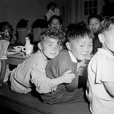 Meaningful Moments: A Japanese-American boy gets a hug from his pal during lunchtime at Raphael Weill Public School in San Francisco, April 1942. Not long after this photo was taken, children of Japanese ancestry (including the pictured boy) were evacuated with their parents to spend the duration of World War II in War Relocation Authority centers.