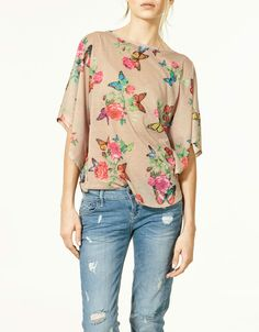 I love the way this shirt lays and it's cute with the worn in jeans. Different fabric for me and I would love it
