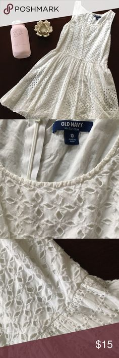 Spring/ Summer Dress Super cute A-line dress. Perfect for the coming warm months. Pretty eyelet dress. Hits me at just above the knee and I am about 5 ft 4 in.  Pairs well with a denim jacket and a tan belt! No known defects. Comes from a smoke free home. Old Navy Dresses Midi