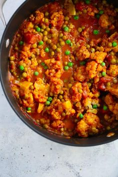 Easy One-Pan Cauliflower Curry Recipe is ready in 20 minutes. It's made with cauliflower, green peas, diced tomatoes, curry and coconut milk. Also this recipe is gluten-free, vegan and if you don't add green peas it's low-carb too. Vegetarian Main Dishes, Vegetarian Recipes, Healthy Recipes, Vegan Vegetarian, Healthy Foods, Free Recipes, Vegetarian Dinners, Cauliflower Curry, Cauliflower Recipes