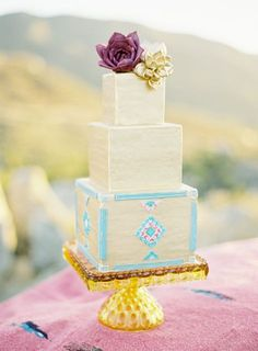 Desert wedding cake topped with gilded succulents