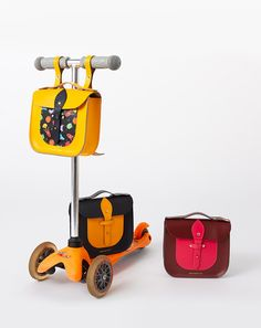 The Rocket Scooter Satchel is a beautiful leather children's bag handmade in a small family run factory in Somerset, England. The satchel can be worn as a backpack and also fastens securely to scooter handlebars with poppers for life's urban adventures. Traditional satchel leather with a fun space print front pocket with sun yellow body and straps. Adjustable shoulder straps and fastens shut with a leather tab and stud. 7.9 x 6.7 x 2.6 inch Made in the UK This school satchel...