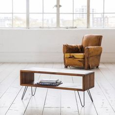 **As Featured in 25 Most Beautiful Homes, January 2014**  This TV table / Credenza is simplicity at its best. Beautiful, functional and made to