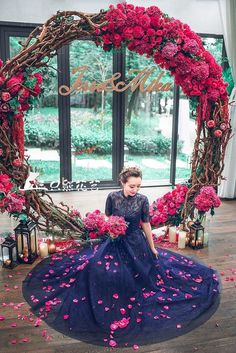 11 More Giant Wedding Wreaths: The Hottest Wedding Trend: #1. Gorgeous bold red and fuchsia wreath as a wedding backdrop, lanterns and candles all around