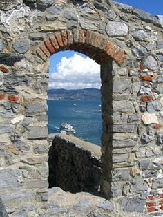 Port of Venus – Portovenere  Portovenere is sometimes considered the 6th Cinque Terre town on the Ligurian Coast.  This portal is part of the castle wall, and gives you a glimpse of the Bay of Poets.  Lord Byron and Shelley once lived and wrote here.