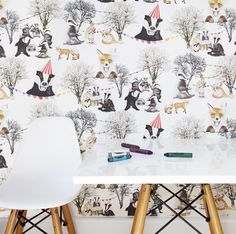 The Woodland Rave print story depicts a picturesque forest scene with urban animals partying until dawn.  A modern 'teddy bears picnic' but with poker playing foxes, break-dancing badgers shaking their moves around a ghetto-blaster, and rabbits enjoying a cup of tea and a cucumber sandwich. Hand-painted and digitally printed, this beautiful printed wallpaper and fabric designed to captivate young minds, is perfect for a kids playroom or children's bedroom.